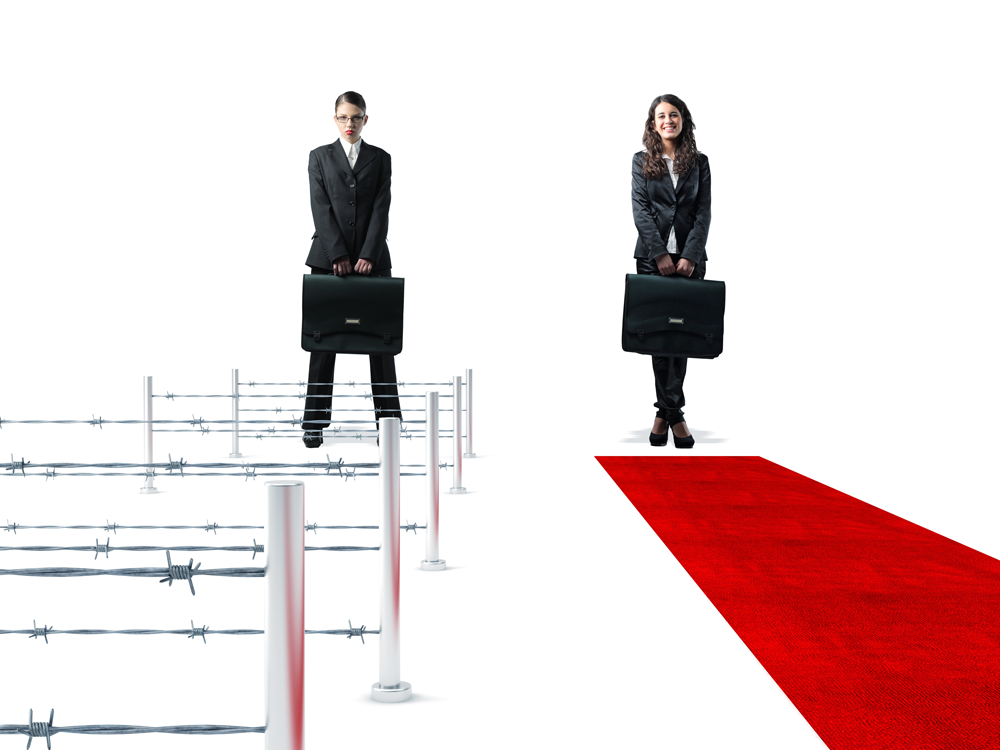 Two women in business suits survey what is in front of them. One stands before hurdles with barbed wire strung between them. The other has a red carpet laid out before her. Wouldn't you like to know which you might be?